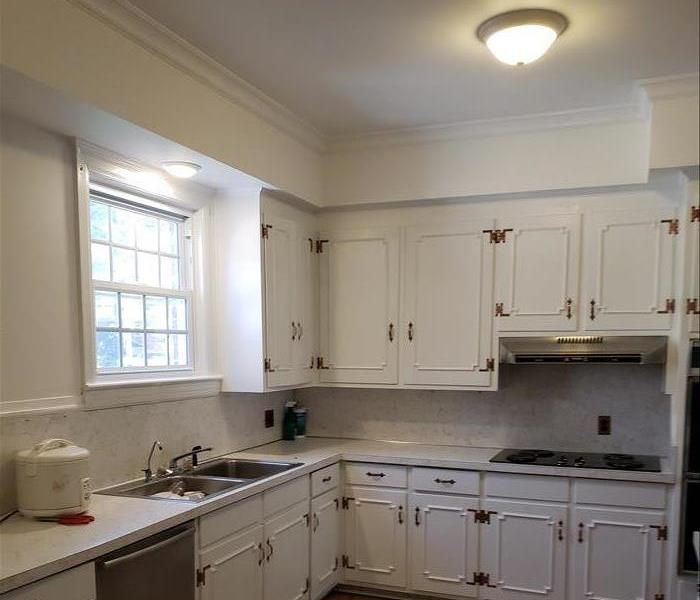 kitchen with repaired ceiling and fresh paint