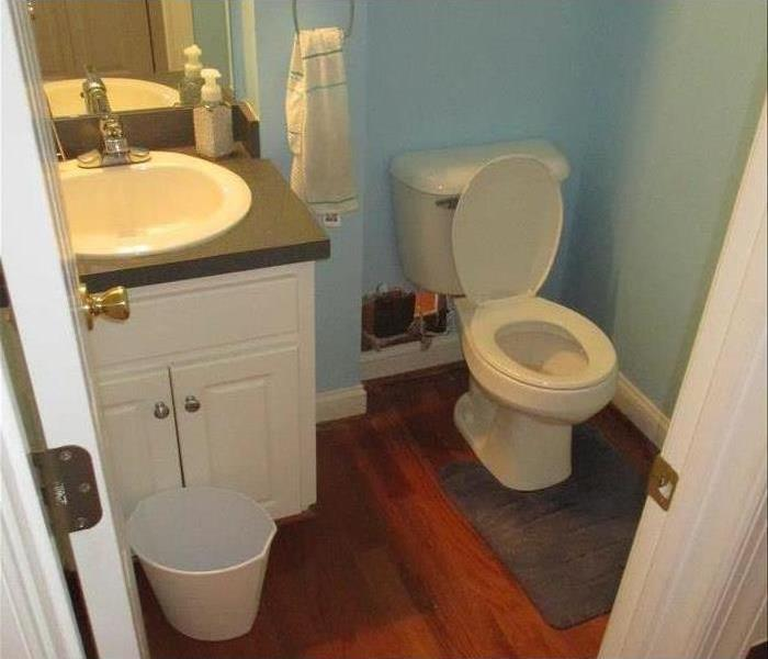 Clean bathroom with new flooring and finished repairs
