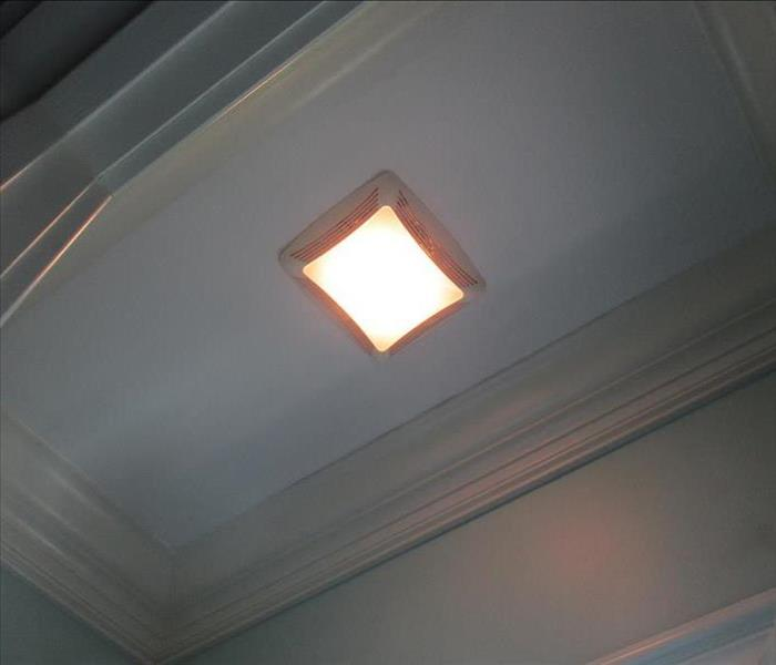same bathroom ceiling has been cleaned and painted