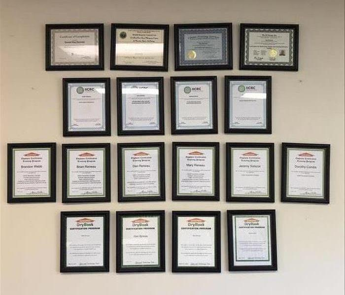 Servpro of Wilson/Nashville office wall with certifications in frames
